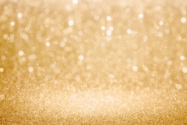 Sfondo di luci glitter oro e bokeh