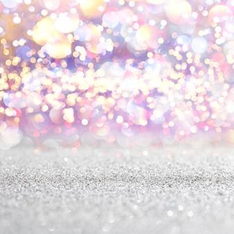 Sfondo di luci vintage argento e bianco glitter. defocused