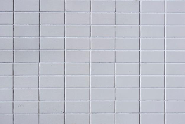 Sfondo di muro di mattoni grigi