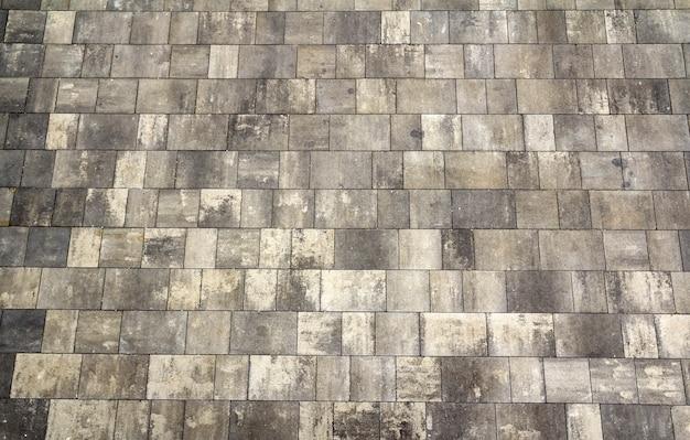Sfondo di piastrelle grigie. struttura classica della parete delle mattonelle per l'interno. trama senza soluzione di continuità. pattern di sfondo.