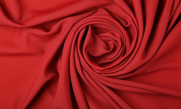 Sfondo di pieghe pieghe tessili rosse