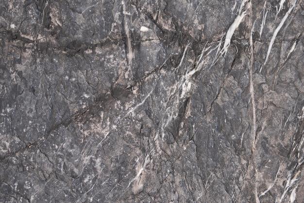 Sfondo di pietra grigio scuro con rotto