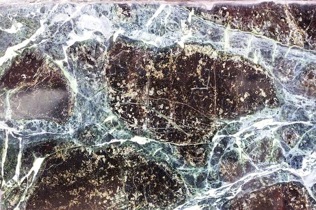 Sfondo di pietra nera con fessure, marmo nero