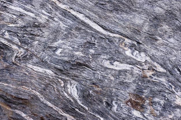 Sfondo di roccia metamorfica piegata