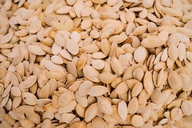 Sfondo di semi di zucca organici