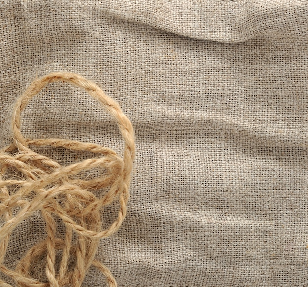 Sfondo di stoffa e corda di lino.