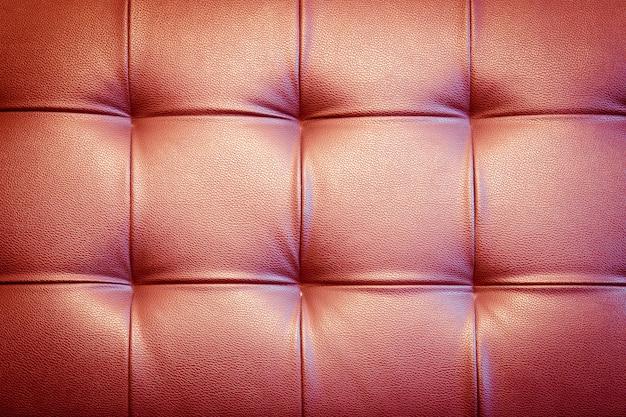 Sfondo di tappezzeria in vera pelle per una decorazione di lusso in tono rosso