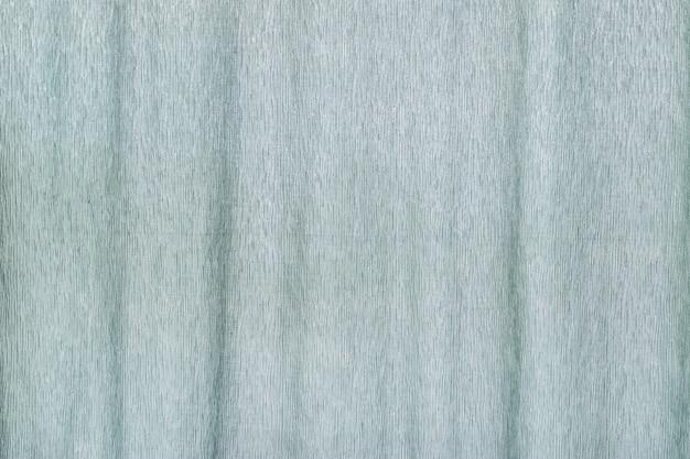 Sfondo di tessuto azzurro della tenda della finestra