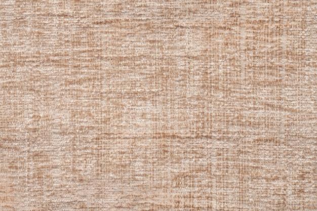 Sfondo di trama tessile beige chiaro