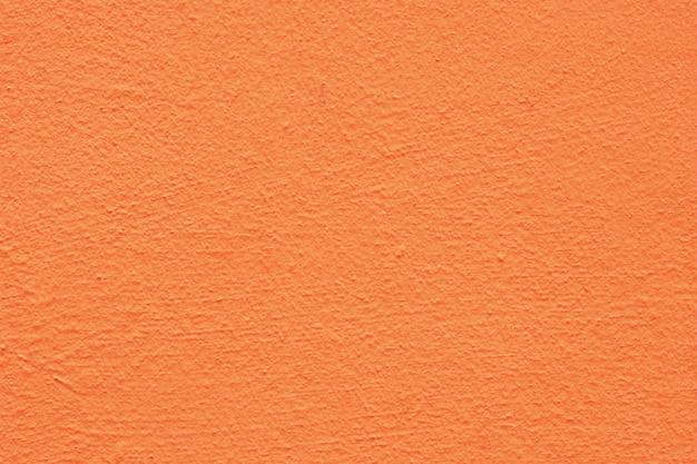 Sfondo di un esterno verniciato e verniciato a stucco giallo