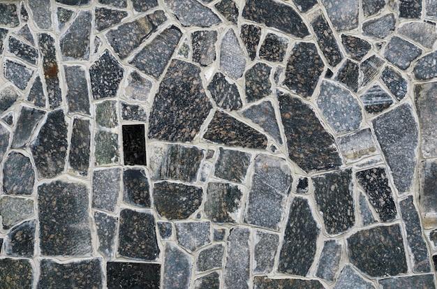 Sfondo di una trama di rivestimento di muro di pietra