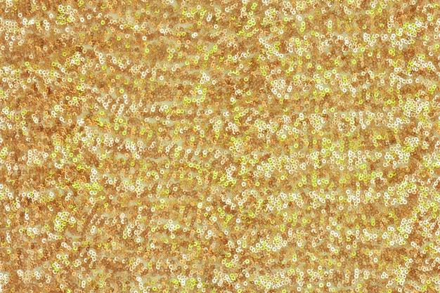 Sfondo festivo astratto con paillettes rotonde con transizione di colore. colori dorati e verdi.