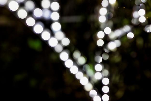 Sfondo festivo incandescente di notte