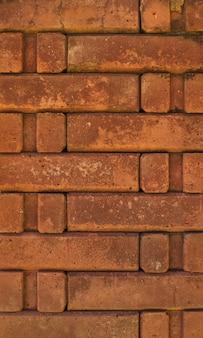 Sfondo full frame 0f il muro di mattoni arancione