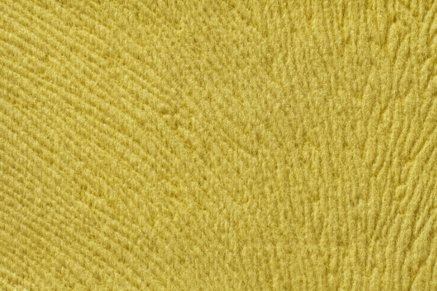 Sfondo giallo da materiale tessile morbido. tessuto con trama naturale.