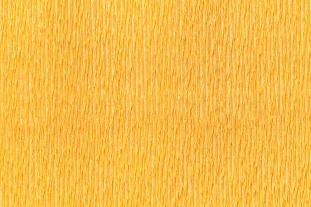 Sfondo giallo strutturale di carta ondulata ondulata