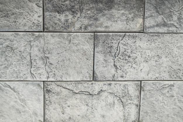 Sfondo grigio cemento e piastrelle di cemento, struttura di pietra