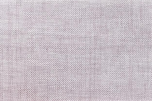 Sfondo grigio chiaro di tessuto insacchettamento denso, primo piano