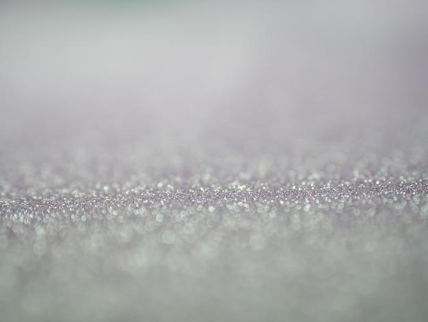 Sfondo grigio glitter astratto con bokeh. luci sfocate