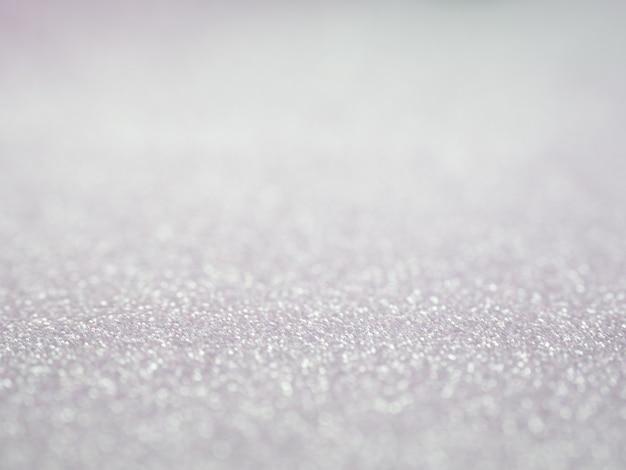 Sfondo grigio glitter astratto con bokeh