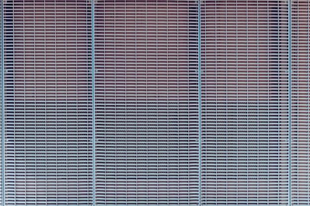 Sfondo grigio griglia metallica