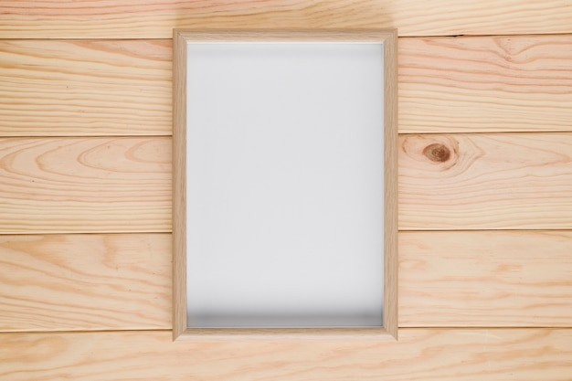 Sfondo in legno con cornice vuota