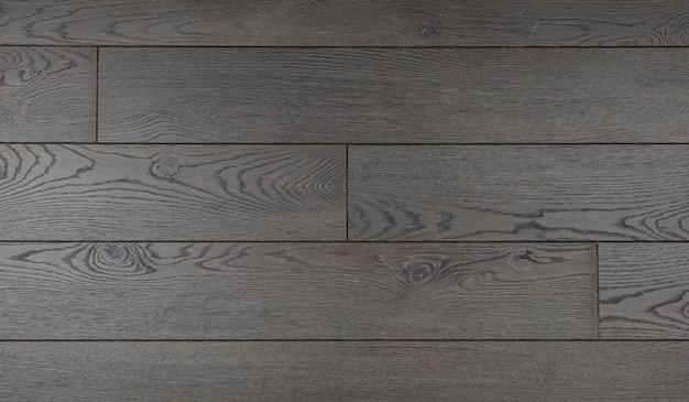 Sfondo laminato pannelli in legno laminato e parquet per il pavimento nel design degli interni. texture e pattern di legno naturale