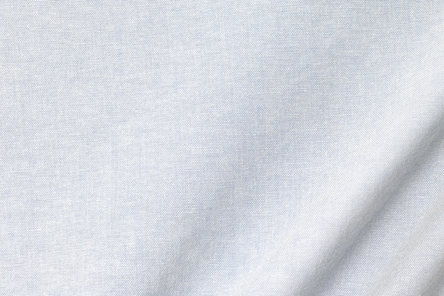 Sfondo leggero trama di cotone. dettaglio della superficie del tessuto tessile.