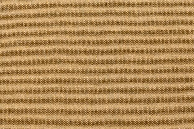 Sfondo marrone chiaro da una materia tessile con motivo in vimini