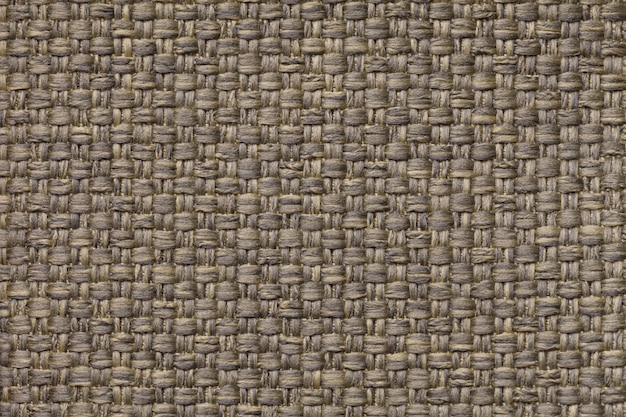 Sfondo marrone chiaro tessile con motivo a scacchi, primo piano. struttura della macro di tessuto.