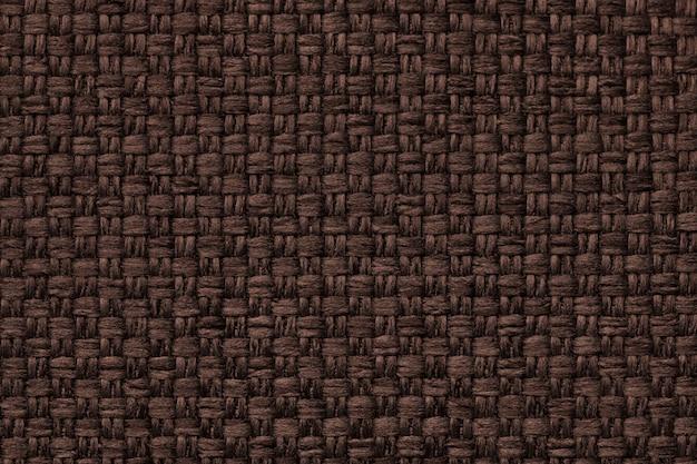 Sfondo marrone con motivo a scacchi, primo piano. struttura della macro di tessuto.