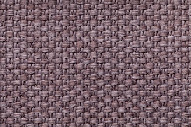 Sfondo marrone con motivo a scacchi struttura della macro di tessuto.