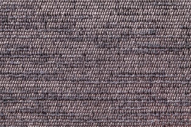 Sfondo marrone da materiale tessile morbido, tessuto con trama naturale,