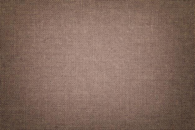 Sfondo marrone da un materiale tessile con motivo in vimini
