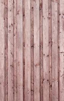 Sfondo marrone in legno. trama grunge. sfondo verticale.