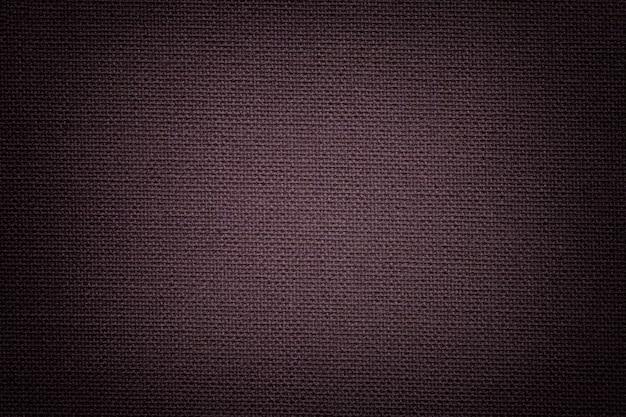 Sfondo marrone scuro da materiale tessile, tessuto con trama naturale,