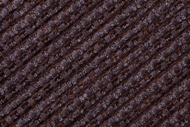 Sfondo marrone scuro dal tessuto motivo a scacchi