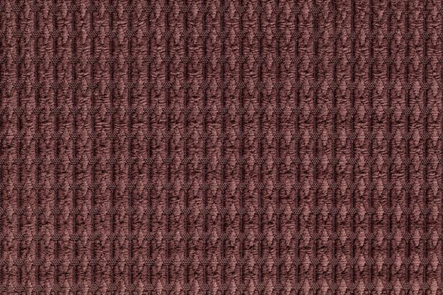 Sfondo marrone scuro dalla fine morbida del tessuto lanoso in su. trama di tessuti macro