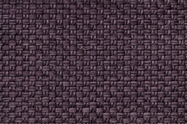 Sfondo marrone scuro tessile con motivo a scacchi, primo piano, struttura della macro di tessuto,