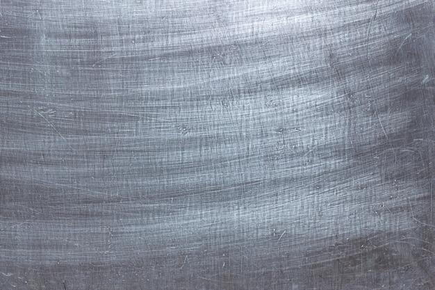 Sfondo mettalic sporco con graffi, trama di ferro con spazzole da pennello