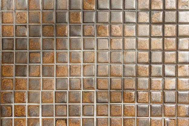 Sfondo muro di mosaico marrone