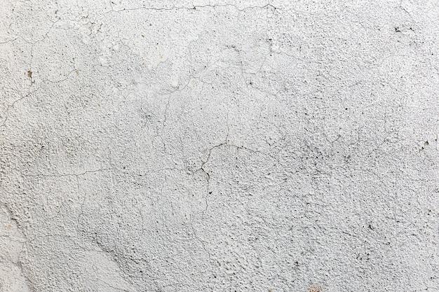 Sfondo muro strada invecchiato, trama con crepe e graffi
