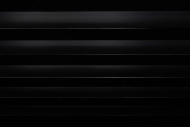 Sfondo nero 3d con strisce bianche
