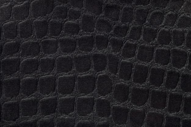 Sfondo nero da un morbido materiale tessile da tappezzeria