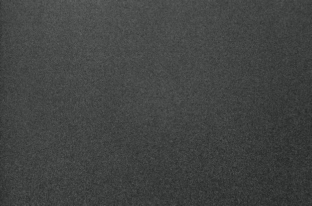 Sfondo nero di plastica granulosa