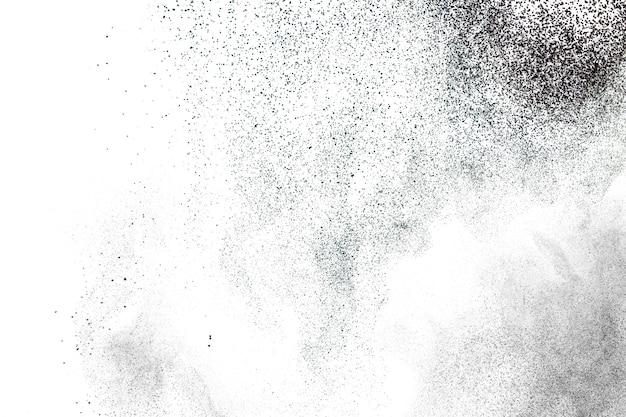 Sfondo nero splatter in polvere. trama di particelle di polvere