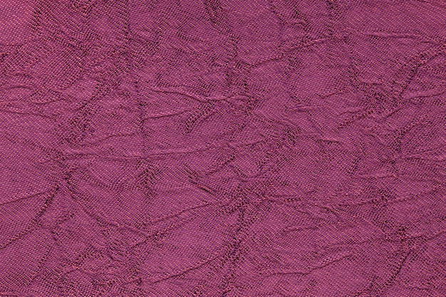 Sfondo ondulato viola scuro da un materiale tessile