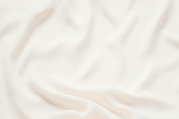 Sfondo opaco in morbido tessuto plissettato crema opaca. liscio elegante trama di lusso del panno.