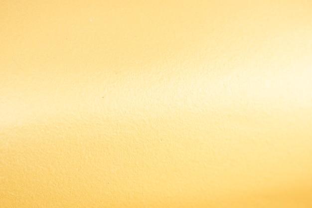 Sfondo oro o texture e sfumature ombra.