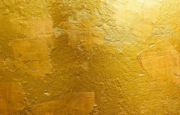 Sfondo oro o trame e ombre, vecchie mura e graffi